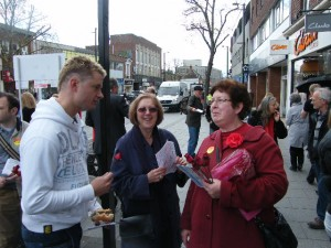 Gillian Norris and Ann Huish campaigning on Red Rose Day in Brentwood High Street